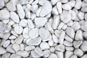 White stones at a grave as a background