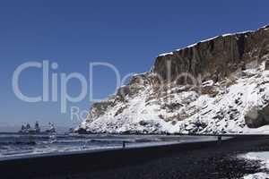 Wide lens capture of the three pinnacles of Vik, Iceland in wint