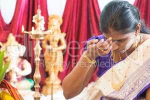 Hindu woman putting bindi