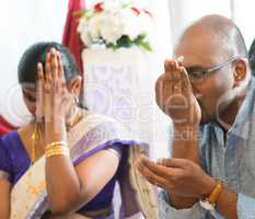 Indian people received prayers from priest