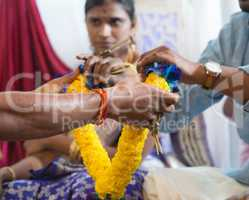 Indian people received flower garland from priest.