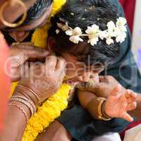 Traditional Indian Hindu family ear piercing ceremony