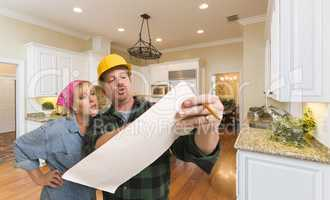 Contractor Discussing Plans with Woman Inside Custom Kitchen Int