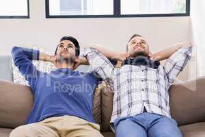 Gay couple relaxing on the couch