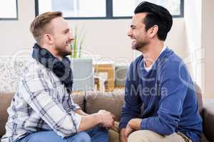 Gay couple laughing together