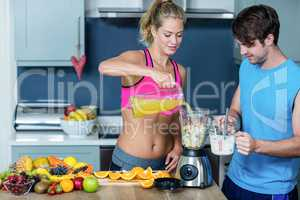 Healthy couple preparing a smoothie