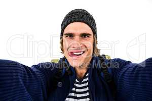 Backpacker holding the camera and grimacing