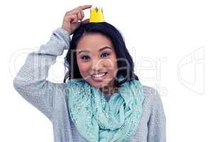 Asian woman pointing her paper crown