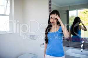 Pretty woman with headache in blue