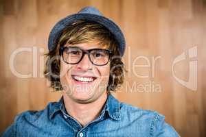 Smiling blond hipster staring at camera
