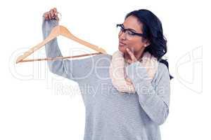 Asian woman holding wooden hanger