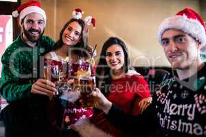 Festive friends drinking beer and cocktail