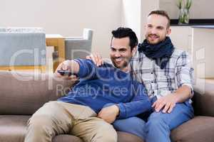 Gay couple watching television