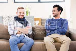 Gay couple smiling on the couch