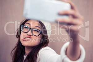 Asian woman making faces and taking selfie