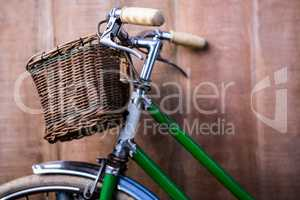 Close up view of a old green bike