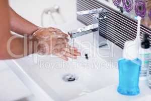 Close up of washing hands with soap under running water