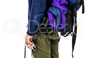 Midsection of backpacker hipster holding camera