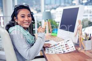 Asian businesswoman holding paper sheet