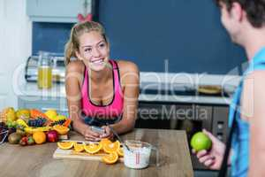 Healthy couple talking and holding fruit