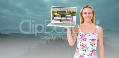 Composite image of smiling blonde holding laptop and posing