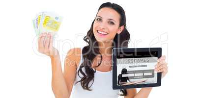 Composite image of pretty brunette using tablet pc