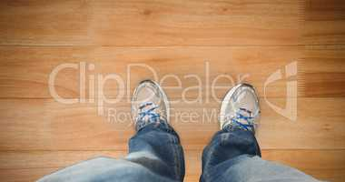 Composite image of casually dressed mans feet