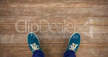 Composite image of man with canvas shoes on hardwood floor