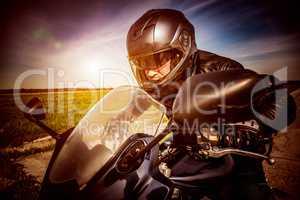 Biker racing on the road