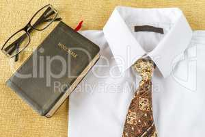 Christian man style clothes and Holy Bible at home