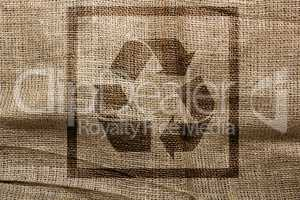 Stamp on sackcloth industrial recycling symbol