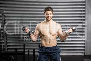 Front view of serious man lifting weight