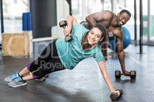 Athletic man and woman working out