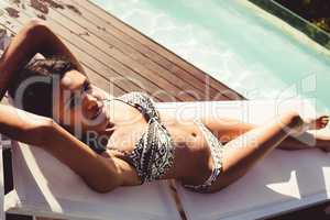 Fit woman lying on deck chair