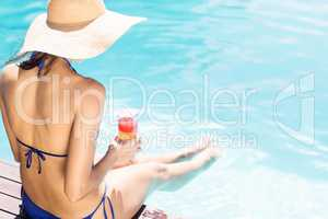 Woman with hat with cocktail