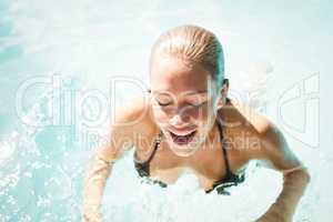 Smiling blonde heading out of water