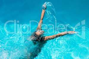 Woman heading out of pool