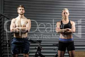 Serious crossfit couple posing