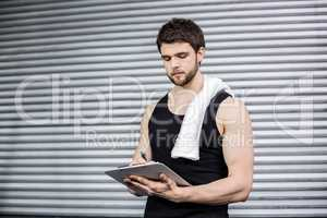 Trainer taking notes at crossfit gym