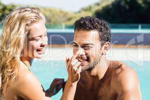 Girlfriend applying cream to boyfriend