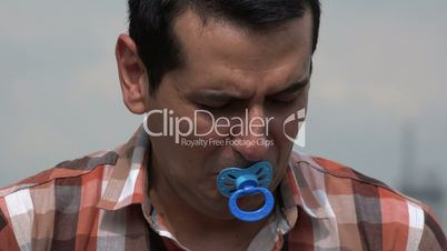 Adult Man Crying With Pacifier