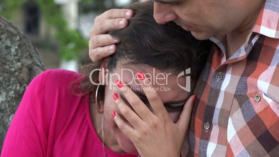 Woman Crying On Man?s Shoulders
