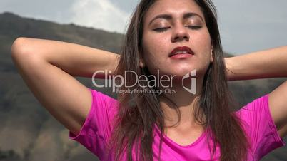 Content Woman Relaxing In Mountains