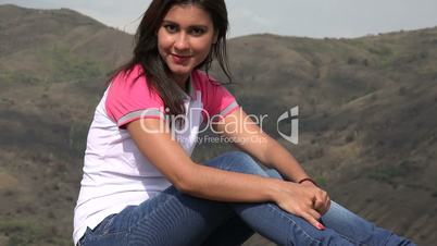 Pretty Woman Sitting In Mountains