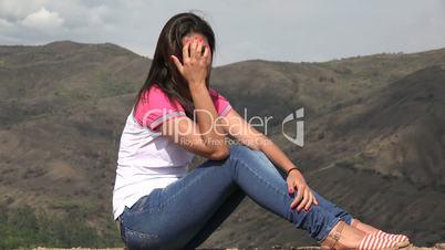 Woman Sitting In Mountains