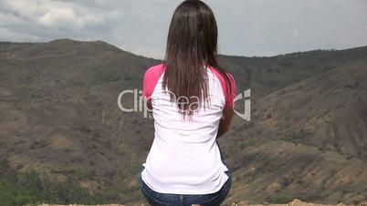 Woman Sitting With Mountain Vista
