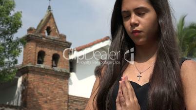 Teen Hispanic Girl Praying at Church