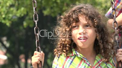 Mentally Disabled Boy on Swing Set