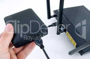 Router with backup storage disk. DLNA media server from USB disk