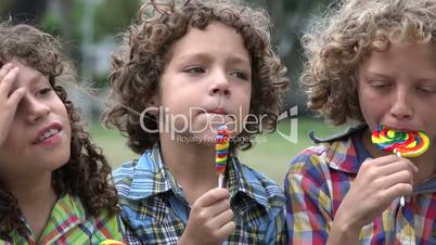 Brothers Eating Lollipop Candy